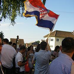 Crowd waving Croation flag