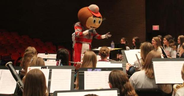 Brutus Buckeye conducting an honor band