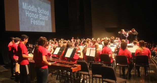 Middle School Honor Band 2019 rehearsal on Mershon stage