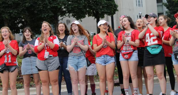 Singing at a tailgate on Game Day