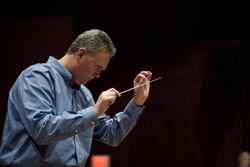 Russel Mikkelson conducting