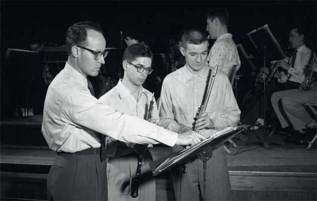 Donald McGinnis instructs Concert Band students, 1955.