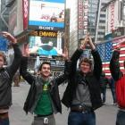 Students spell out O-H-I-O with their arms in Times Square, New York.