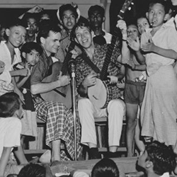 Bill Crofut and Steve Addiss, American folk singers, with children in Burma (now Myanmar). Photo courtesy of Danielle Fosler-Lussier.