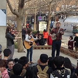 Trio performing in China square