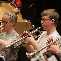 Middle school students in band rehearsal