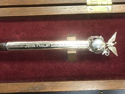 Sousa's name engraved on baton
