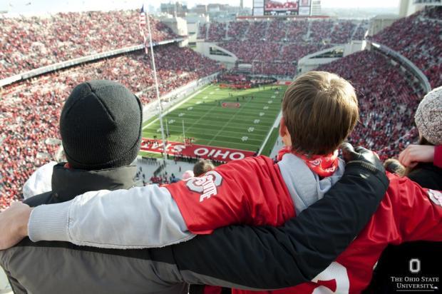 Students singing Carmen Ohio in the stadium
