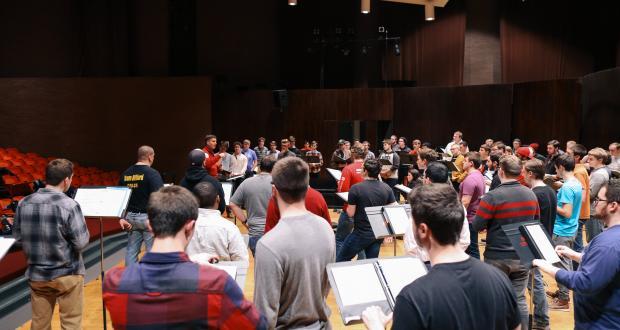Men's Glee Club rehearsal in Weigel Hall Auditorium