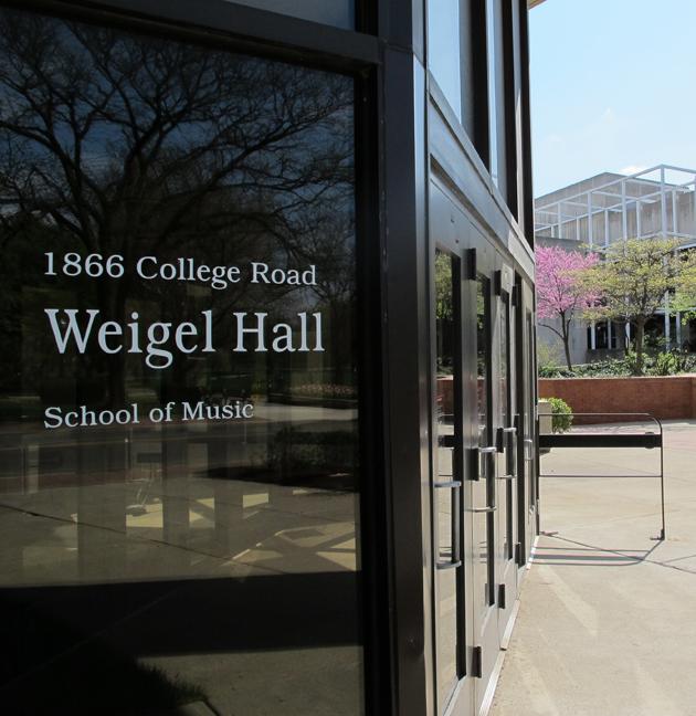 Weigel Hall sign on front glass door to Weigel Hall